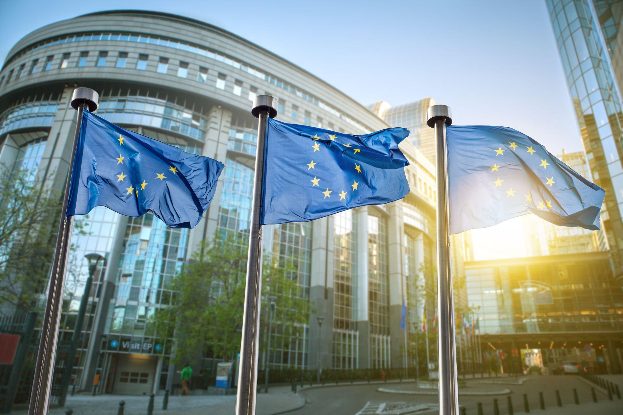 European union flag against parliament in Brussels, Belgium